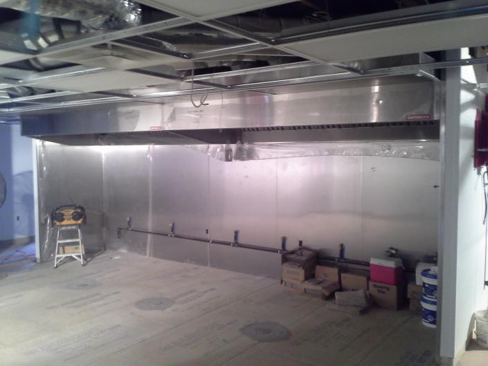 [Image: The before picture of the Green Papaya's kitchen before our crew came in to install the kitchen equipment.]