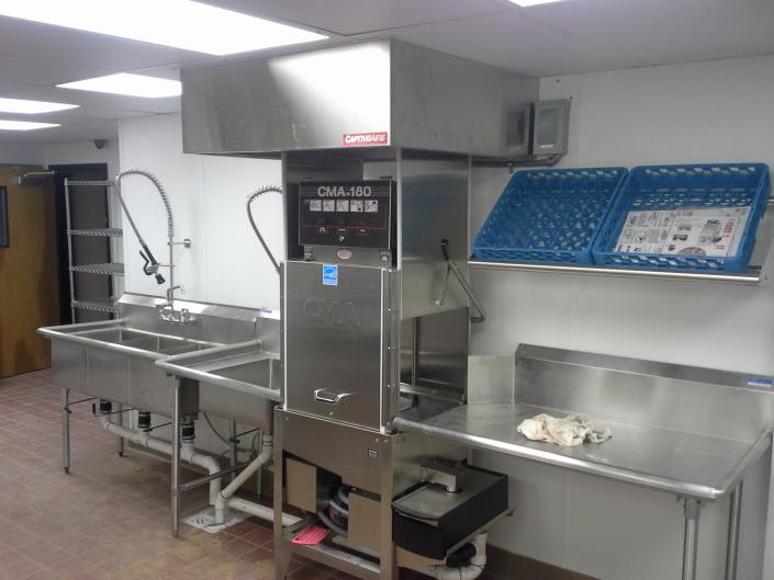 [Image: After we designed and rebuilt the kitchen area, we installed their new kitchen equipment.]