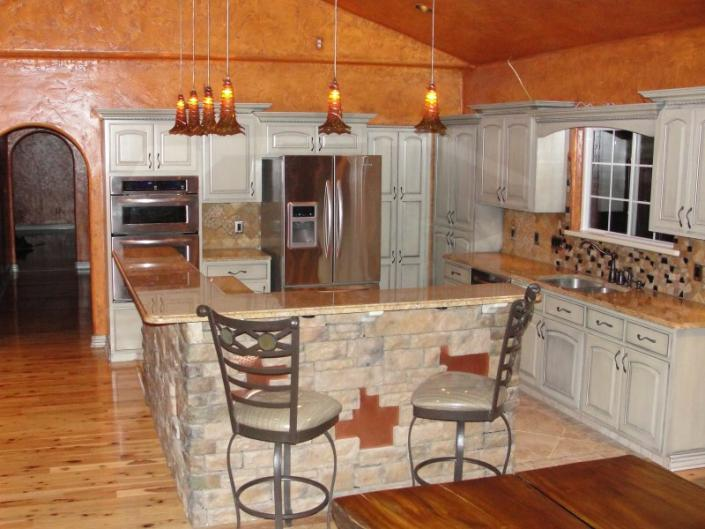 [Image: AC/DC Electrical Contracting Company Inc. completely designed this kitchen and installed everything from the island to the light fixtures.]